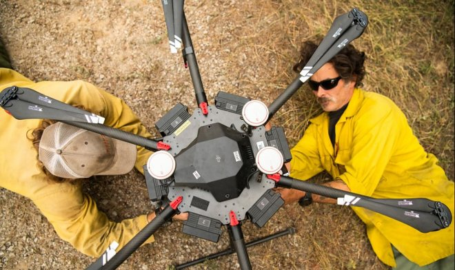 US firefighters fight the fire with the help of bombardier drones