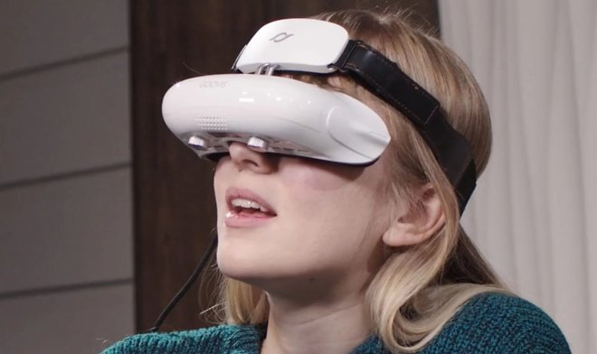 The GOOVIS headset will move the movie theater 's giant screen to virtual reality
